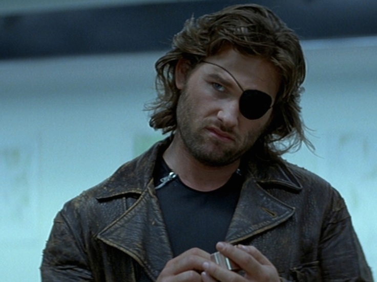 escape-from-new-york-1981-001-kurt-russell-one-eye-medium-shot-1000x750